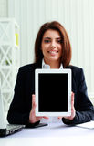 Beautiful businesswoman showing display of a tablet computer Stock Photo