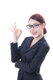 Beautiful businesswoman showing ok sign Royalty Free Stock Photography