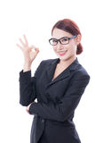 Beautiful businesswoman showing ok sign Stock Photography