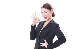 Beautiful businesswoman showing ok sign Royalty Free Stock Images