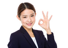 Beautiful businesswoman?showing okay sign Royalty Free Stock Image