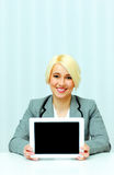 Beautiful businesswoman showing screen of a tablet computer Stock Photography