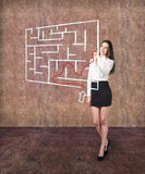 Beautiful businesswoman showing something in  maze Royalty Free Stock Images