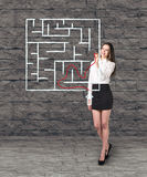 Beautiful businesswoman showing something in maze Royalty Free Stock Photos
