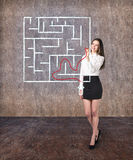 Beautiful businesswoman showing something in  maze Stock Images