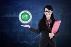 Beautiful businesswoman showing a virtual button Royalty Free Stock Images