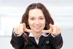 Beautiful businesswoman shows Stock Photo