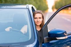 Beautiful businesswoman sitting in the car Royalty Free Stock Images