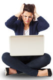 Stressed young businesswoman working on a laptop Royalty Free Stock Photo