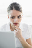 Beautiful businesswoman sitting concentrating at her desk Royalty Free Stock Photo