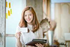 Beautiful businesswoman with smile,showing blank name card Stock Photos