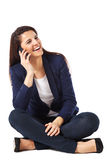 Young business woman sitting talking on smartphone Royalty Free Stock Photo