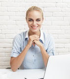 Beautiful businesswoman smiling while sitting at office Royalty Free Stock Photos