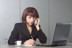 Beautiful businesswoman speaks on the phone Stock Photography