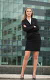 Beautiful businesswoman standing outside building Royalty Free Stock Photo