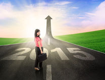 Beautiful businesswoman standing on the road Royalty Free Stock Images
