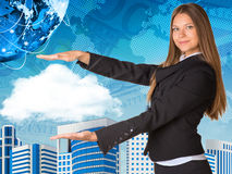 Beautiful businesswoman in suit holding cloud Royalty Free Stock Image