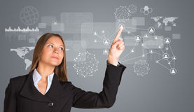 Beautiful businesswoman in suit pointing finger on Stock Images