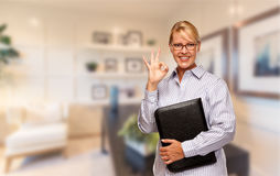 Beautiful Businesswoman In Suit and Tie Standing in His Office Royalty Free Stock Photography