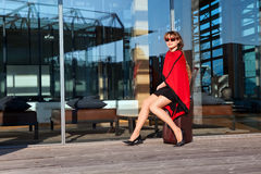 Beautiful businesswoman with suitcase Royalty Free Stock Photography