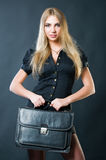 Beautiful businesswoman with suitcase Stock Photo