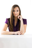 Beautiful businesswoman on a table Stock Image