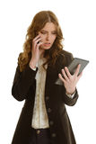 Beautiful businesswoman with tablet calls Royalty Free Stock Images