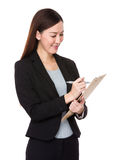 Beautiful businesswoman take note on clipboard Royalty Free Stock Photo