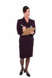Beautiful Businesswoman Taking Notes. Holding pen and clipboard.  Disapointed expression. Shot in studio Stock Image