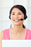 Beautiful Businesswoman talking on headset. At work Royalty Free Stock Images
