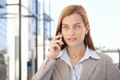 Beautiful businesswoman talking on mobile phone Royalty Free Stock Image