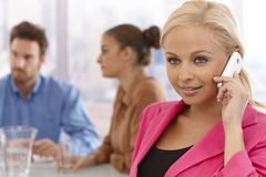 Beautiful businesswoman talking on mobile Stock Image