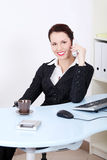Beautiful businesswoman talking by phone. Royalty Free Stock Images