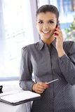 Beautiful businesswoman talking on phone Stock Photography