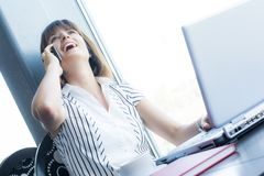 Beautiful businesswoman talking on the phone Stock Images