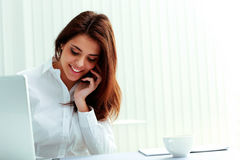 Beautiful businesswoman talking on the phone Royalty Free Stock Photo