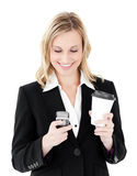 Beautiful businesswoman texting and holding coffee Stock Photos
