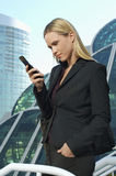 Beautiful Businesswoman Texting Message Royalty Free Stock Image