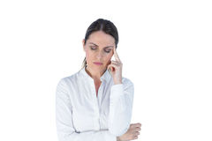 Beautiful businesswoman thinking with finger on head Royalty Free Stock Images