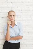 Beautiful businesswoman thinking Royalty Free Stock Photography