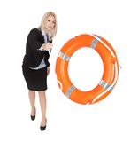 Beautiful businesswoman throwing life buoy Royalty Free Stock Photography
