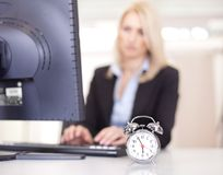 Beautiful businesswoman trying to meet a deadline Stock Photography