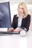 Beautiful businesswoman trying to meet a deadline Royalty Free Stock Images