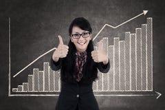 Beautiful businesswoman tumbs up Stock Image