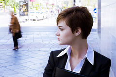 Beautiful businesswoman in urban background Stock Photo