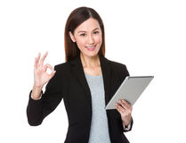 Beautiful businesswoman use of tablet and ok sign gesture Stock Photography