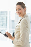 Beautiful businesswoman using digital tablet in office Stock Photo