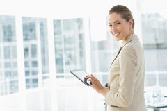 Beautiful businesswoman using digital tablet in office Stock Image