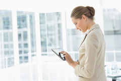 Beautiful businesswoman using digital tablet in office Royalty Free Stock Photography