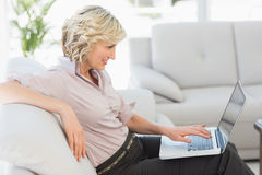 Beautiful businesswoman using laptop in the living room Stock Photo